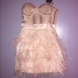 Mini dress with feathered bottom and goldstones